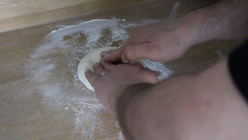 Image showing me stretching Pizza Dough